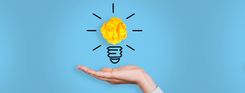 Illustrated lighbulb with scrunched yellow paper, open palm below